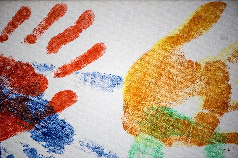 Handprints colorido de vários tamanhos na lona fotografia de stock