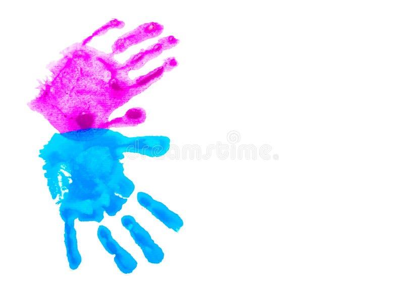 Handprints del rosa y del niño azul aislados en blanco fotos de archivo