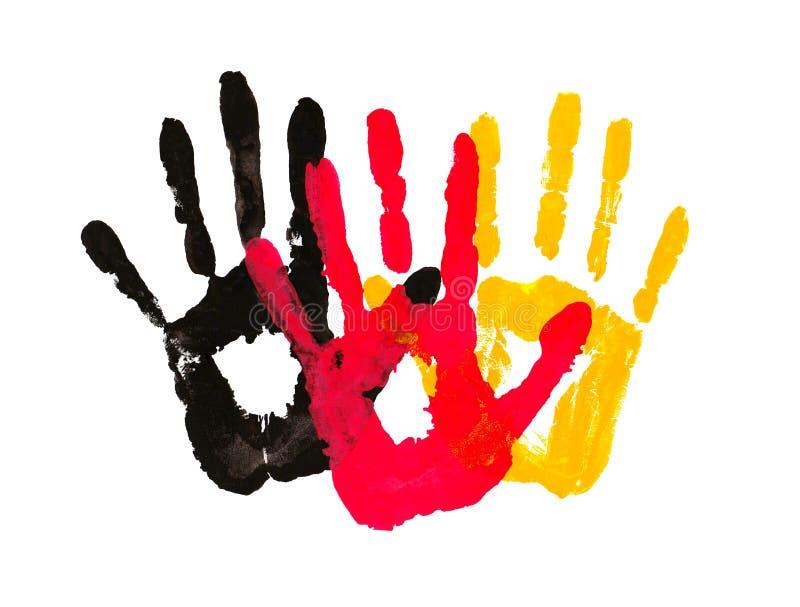 Handprints w postaci flaga Niemcy, wizerunek jedność, wolność, niezależność żółty czarny czerwony atramentu odcisk royalty ilustracja