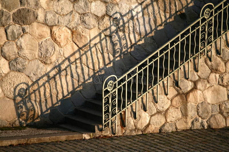 Handrail. Old metal handrail and its shadow royalty free stock photo