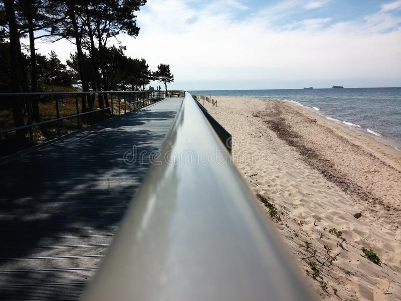 handrail to the sea royalty free stock photo