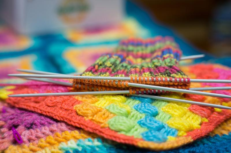 Handrcrafted colorful rainbow scarf beginned to knitting stock image