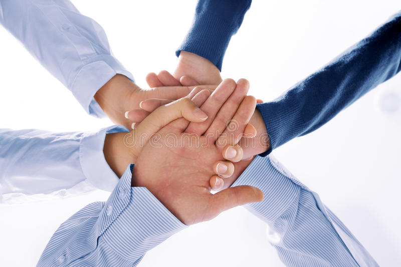 Hands. Close up view of hands getting together on white background royalty free stock photos
