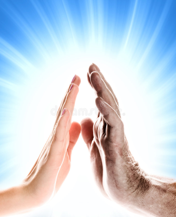 Hands. Of young woman and elderly man over abstract blue background royalty free stock image
