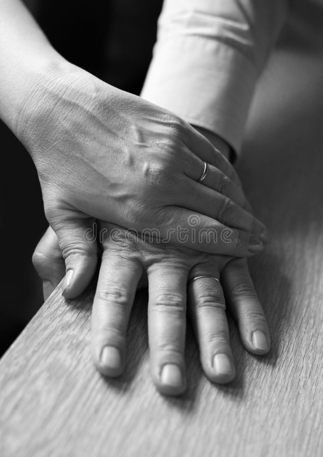 Hands. Of the adult of the man and the woman stock photography