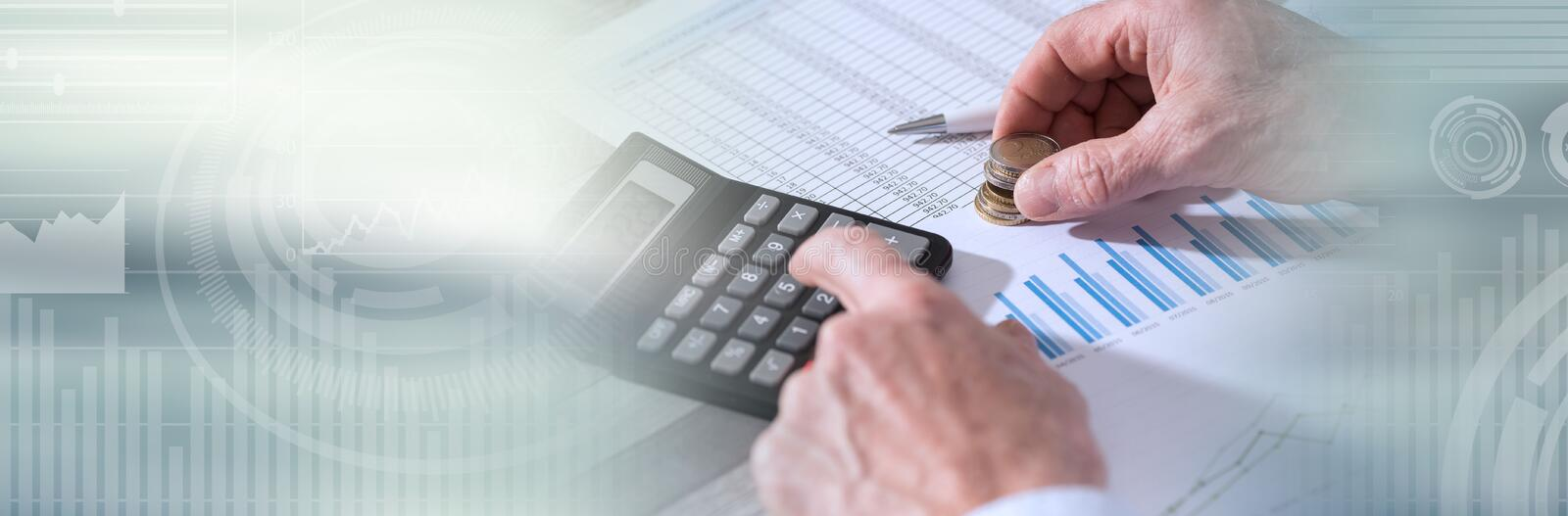 Hands of an accountant working on financial documents. panoramic banner. Hands of an accountant working on financial documents and using a calculator. panoramic royalty free stock photos