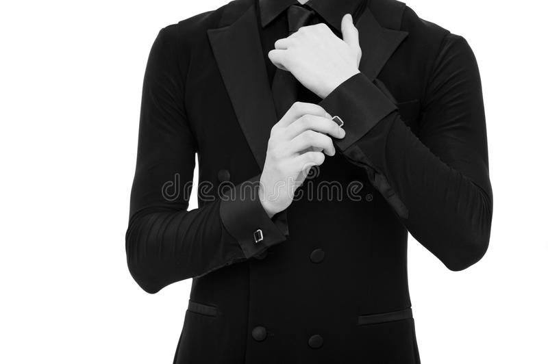 Hands adjust sleeve. Fashionable caucasian male isolated on white background. Formal suit or tuxedo. Used to perfection royalty free stock images