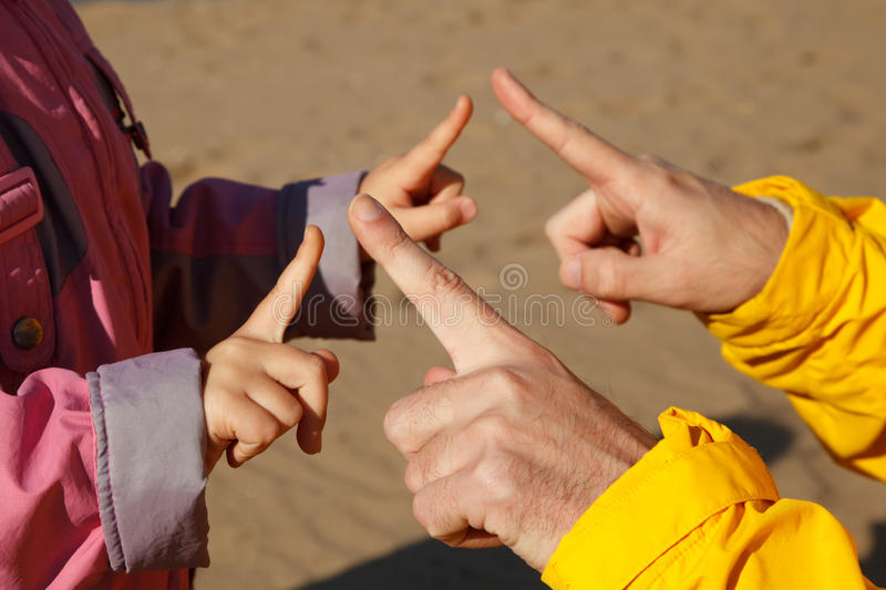 Hands adult and child who play with each other. Photos in open, bright autumn day royalty free stock photos