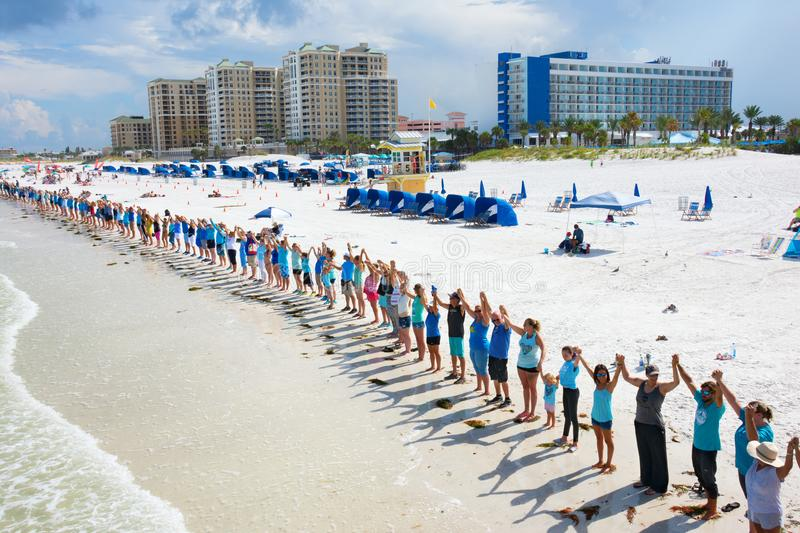 Hands Along the Water in Clearwater Beach Florida to protest toxic algae release from Lake Okeechobee. August 12, 2018 - Clearwater Beach, FL - USA - Hands Along stock image