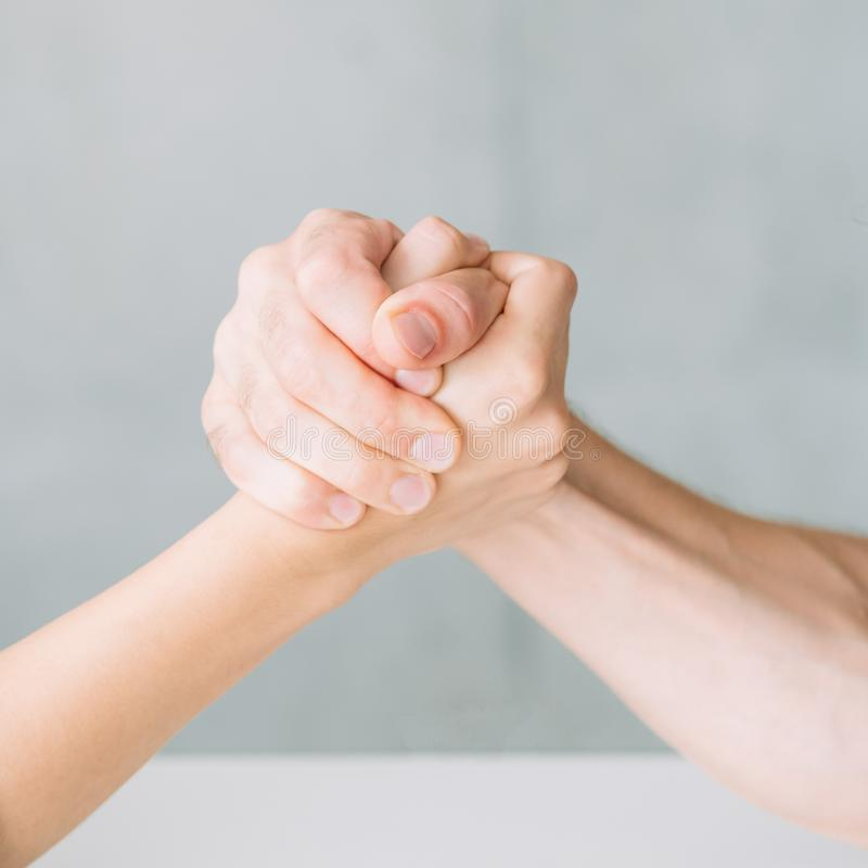 Hands arm wrestling competition fight conflict. Hands in arm wrestling competition. fight conflict and rivalry concept stock photos