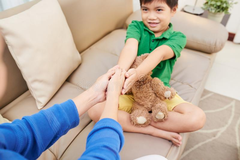 Child playing with mother royalty free stock images