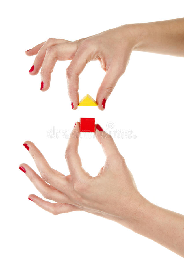 Hands are assembling wooden house stock photo
