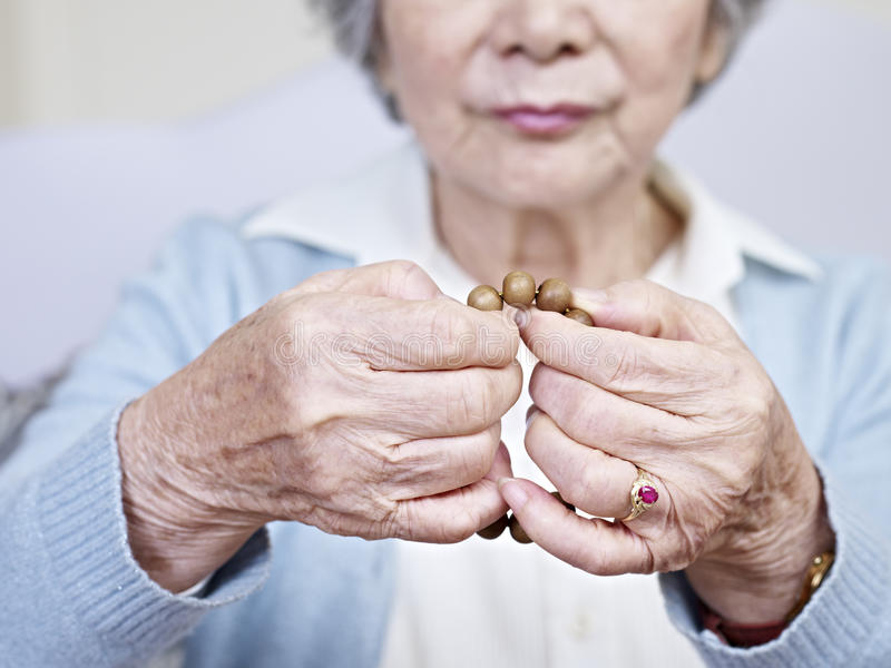 Download Hands and beads stock photo. Image of person, oriental - 31678254