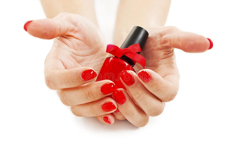 Download Hands With Beautiful Red Nails And Nail Polish Stock Photo