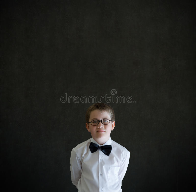 Hands behind back boy dressed up as business man royalty free stock photos