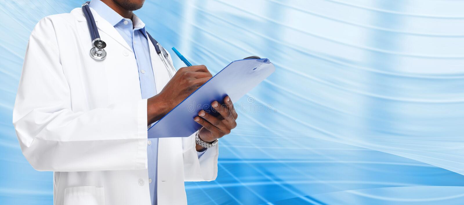 Hands of black doctor man. African-American black doctor man over blue background royalty free stock photography
