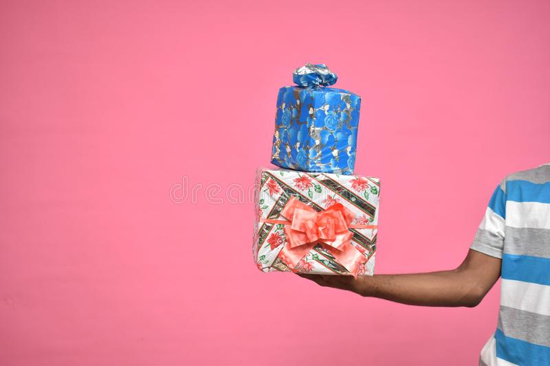 hands only of a black person holding up two gift boxes stock photos