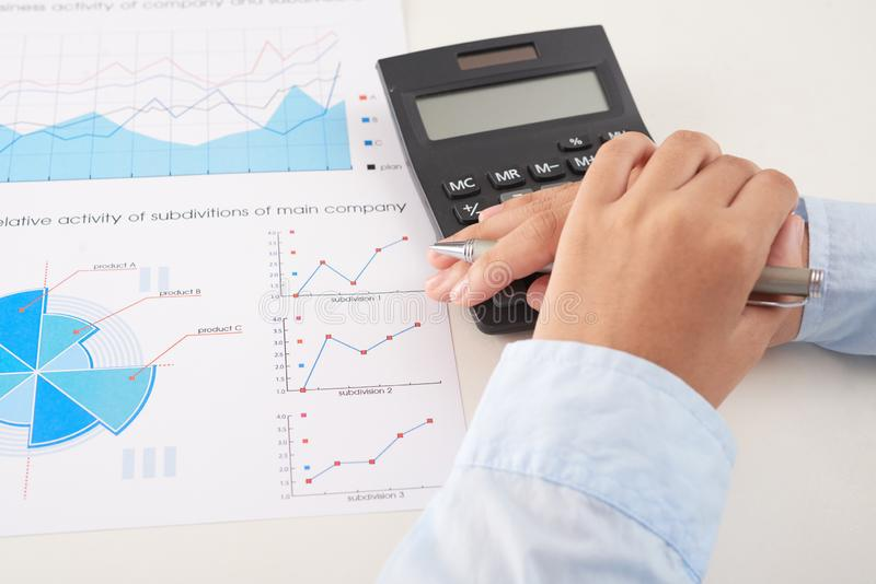 Calculating income stock image