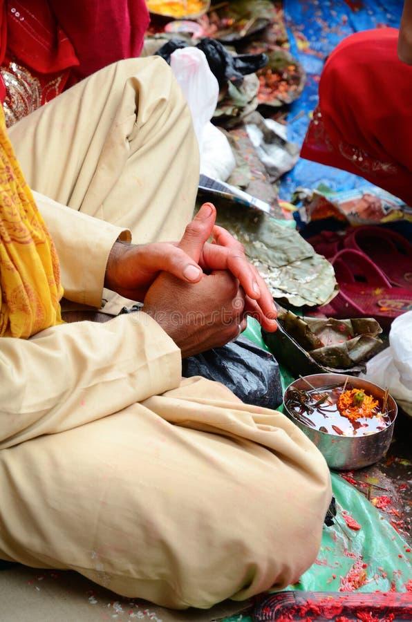 Hands of Brahmin. Hindu Brahmin on celebrating ceremony the Haritalika Teej festival in Kathmandu, Nepal royalty free stock images