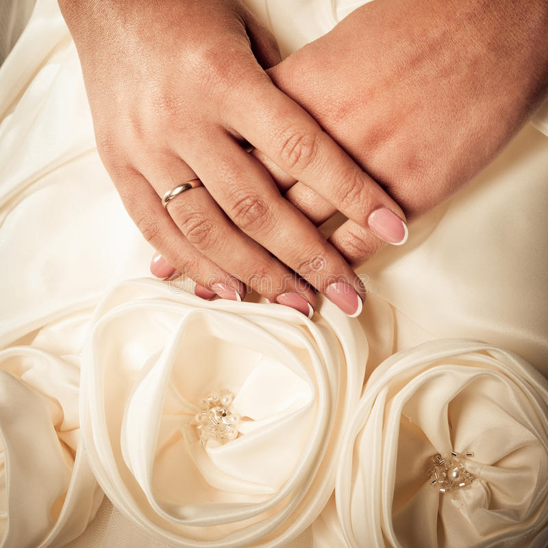 Hands of bride stock images
