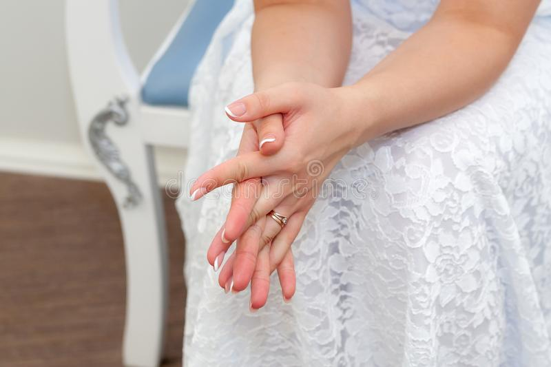The excitement of the bride before the wedding. Hands of the bride, close-up royalty free stock photo