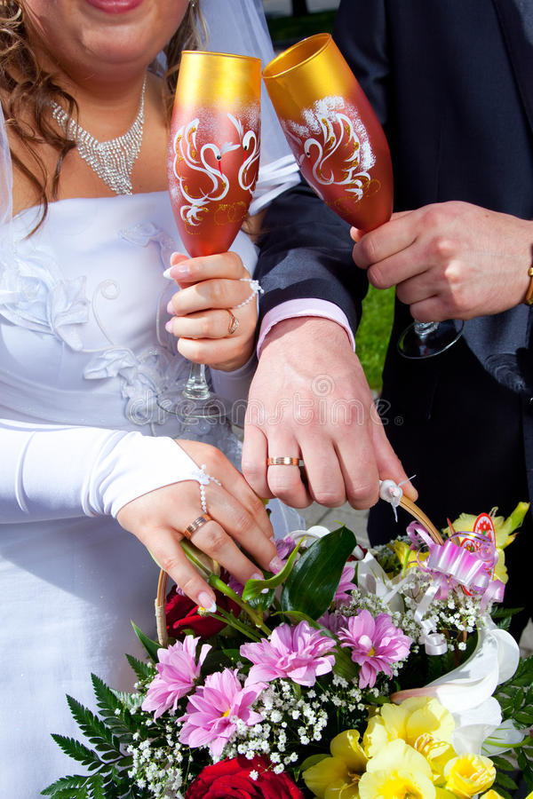 Hands of bride and groom with bouquet royalty free stock image