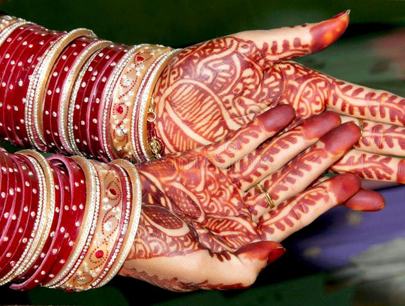 Hands of bride while performing wedding rituals royalty free stock photography