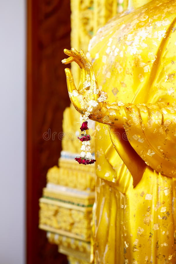 Hands of buddha statue in temple Thailand.selective focus. Golden hands of buddha statue in temple Thailand.selective focus royalty free stock photography