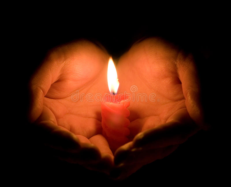 Download Hands and a burning candle stock image. Image of burn - 12694989