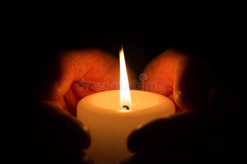 Hands with burning candle royalty free stock photos