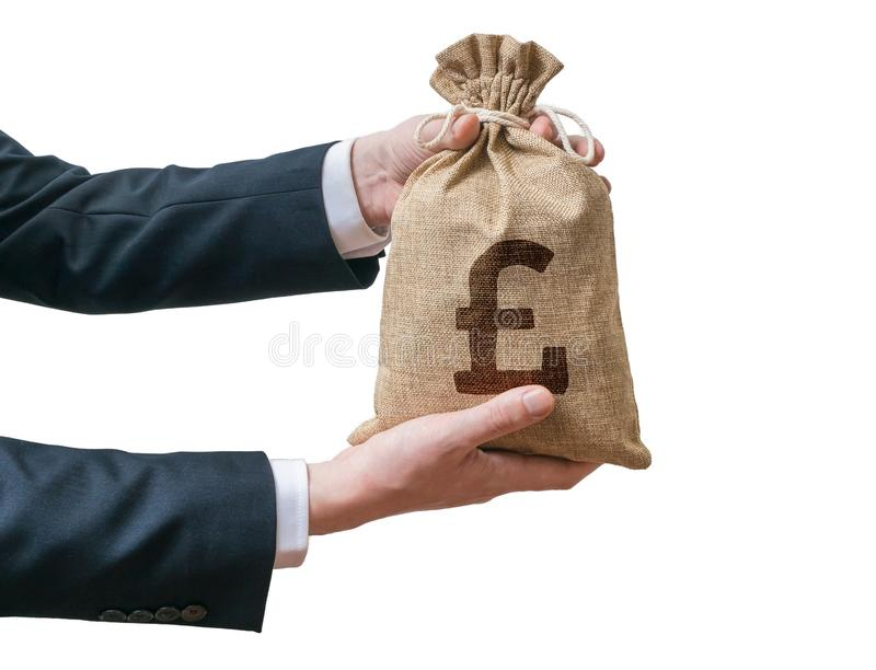 Hands of business man holds bag full of money with British pounds. Hands of business man holds bag full of money with British pound sign. Isolated on white royalty free stock photo