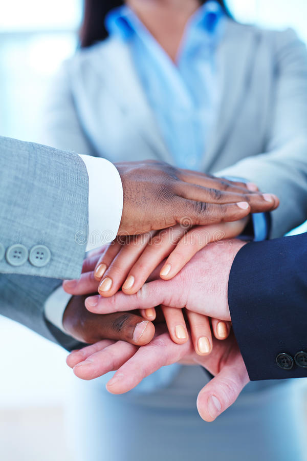 Hands of business partners stock photos
