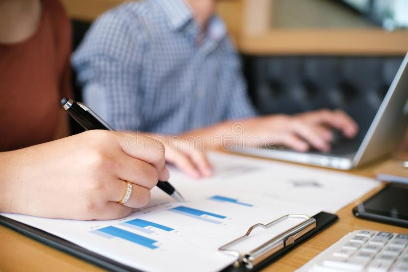 Hands of business people analyzing chart Finance managers task stock photography