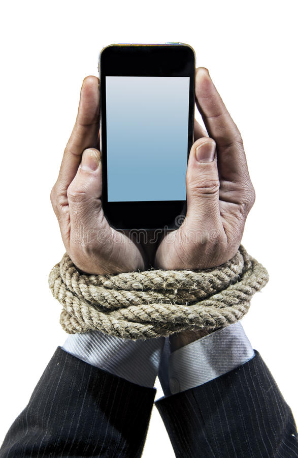 Hands of businessman addicted to mobile phone rope bond wrists in smartphone internet addiction stock images