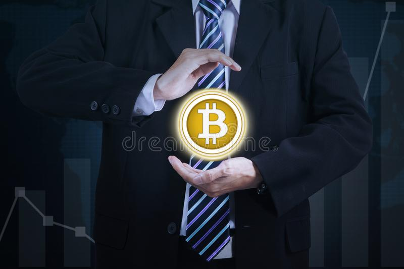 Hands of businessman holding bitcoin virtual stock photography