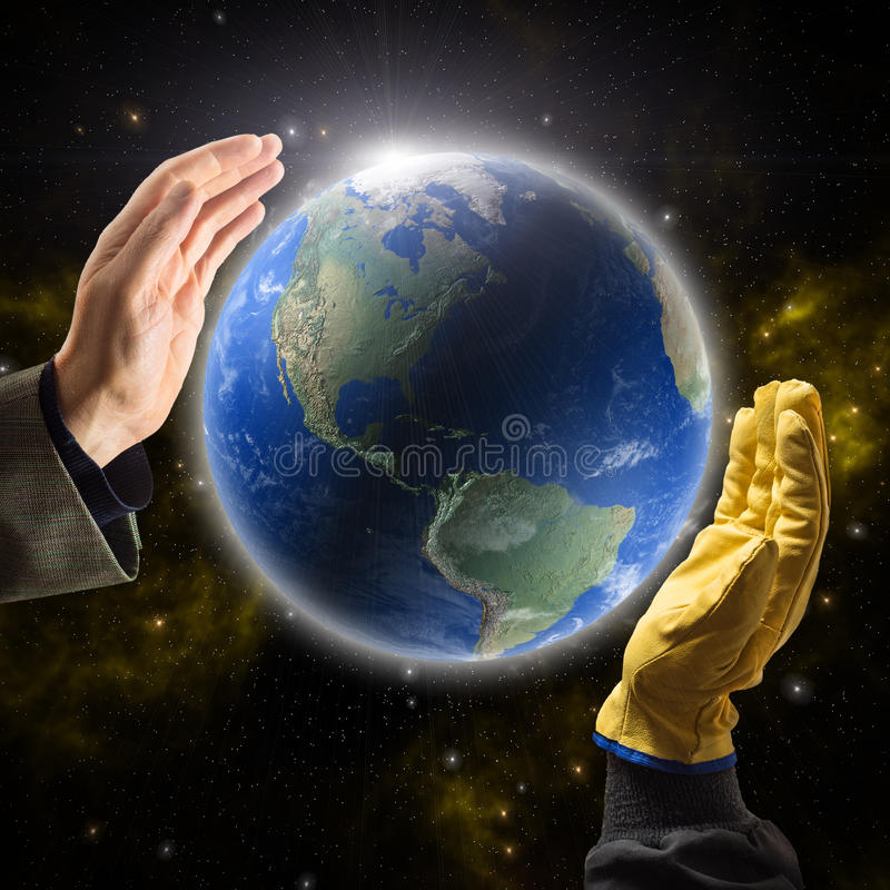 Hands of businessman and worker holding Earth. Hands of businessman and worker holding Planet Earth royalty free stock photography