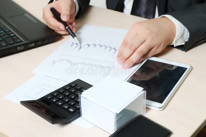 Hands of businessman working with laptop and documents royalty free stock photo