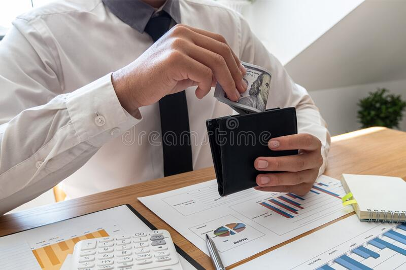The hands of businessmen carrying dollars and wallets in order to save money, grow a successful business and save for retirement stock image