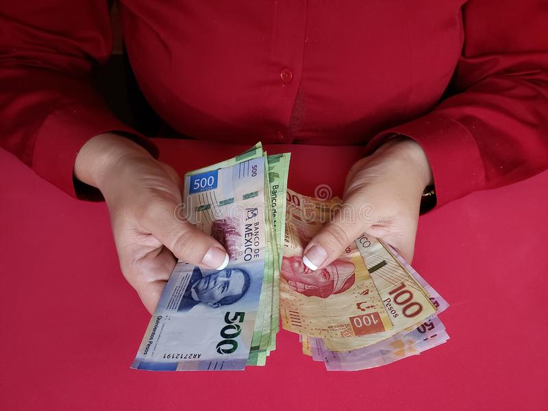 hands of a businesswoman counting mexican banknotes royalty free stock images