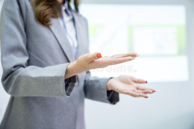Hands of businesswoman present project royalty free stock photo