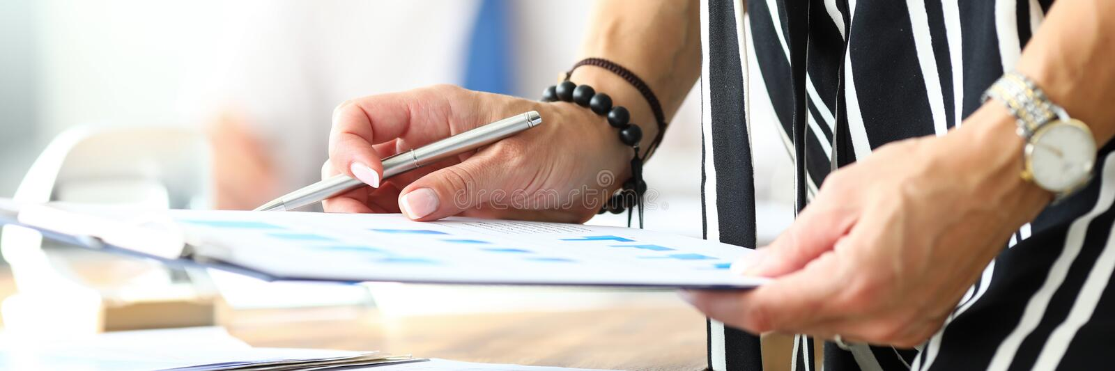 Hands of businesswoman working with financial documents. Letterbox view of hands of businesswoman working with financial documents close-up. Bookkeeping royalty free stock images