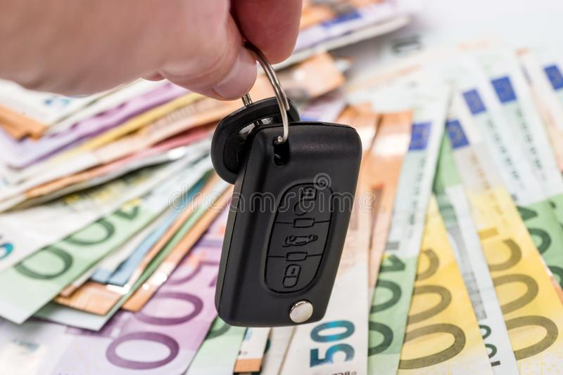 Hands with car keys on euro money background stock photo