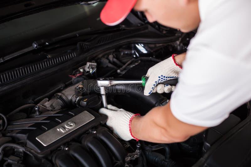 Hands of car mechanic stock photo