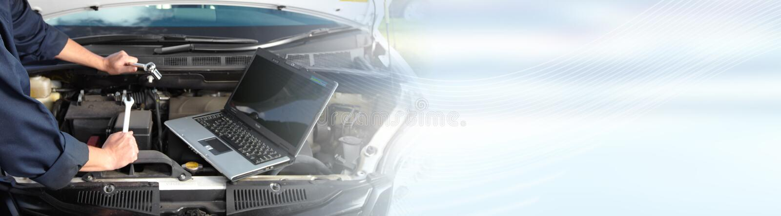 Car mechanic working in auto repair service. stock images