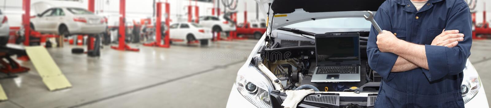 Hands of car mechanic with wrench in garage. Hands of car mechanic with wrench in auto repair service royalty free stock images
