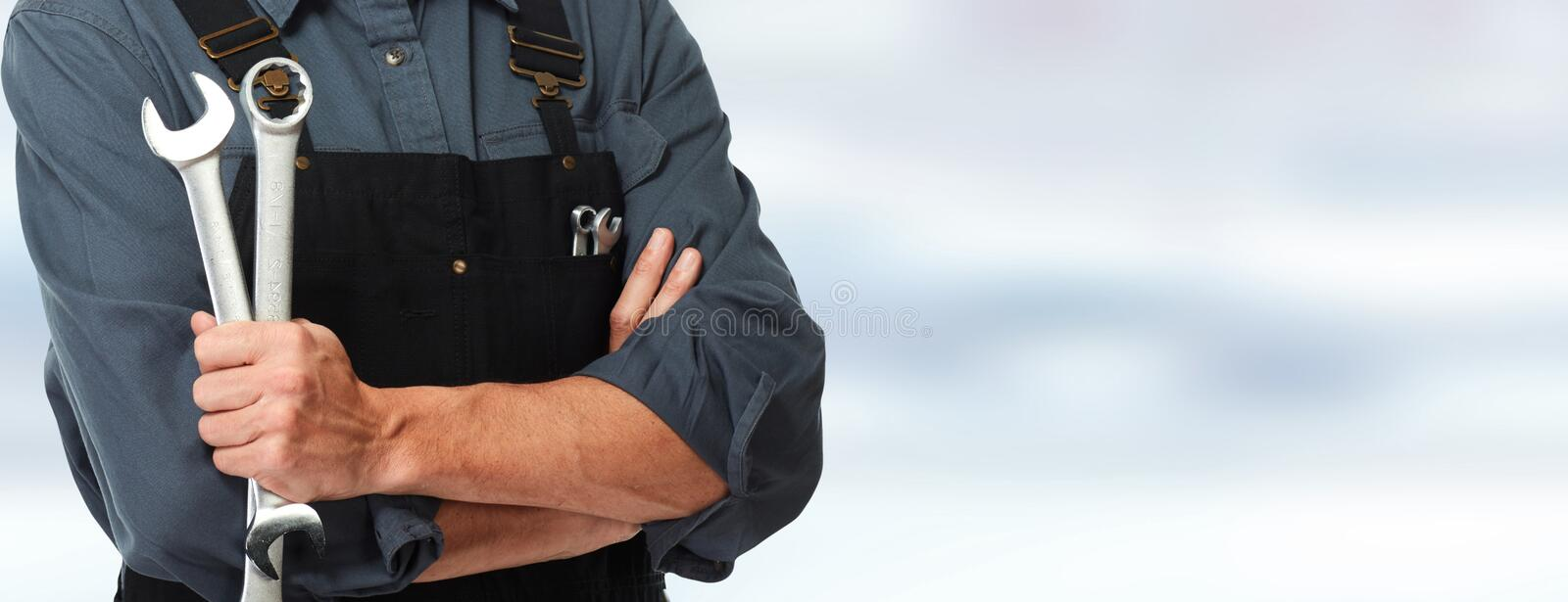 Hands of car mechanic with wrench stock photography