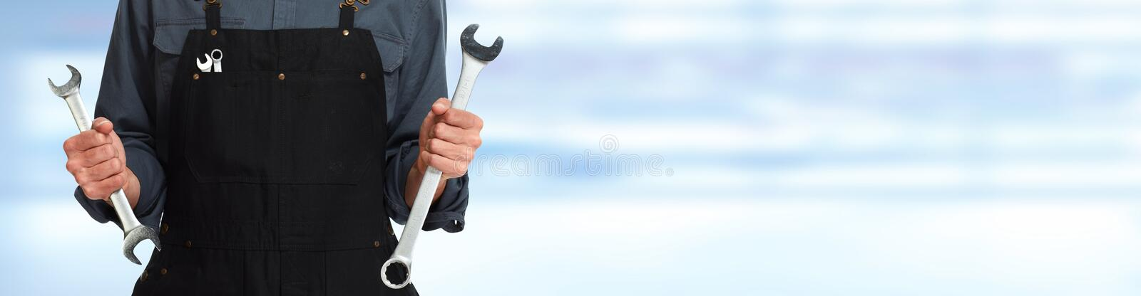 Hands of car mechanic with wrench stock photos