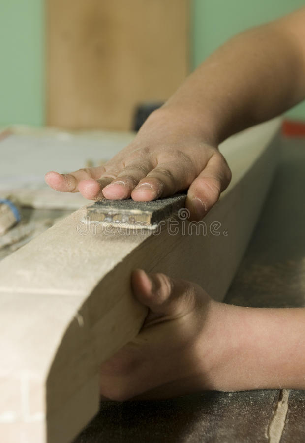 Download Hands of carpenter stock photo. Image of fingers, plane - 24812048