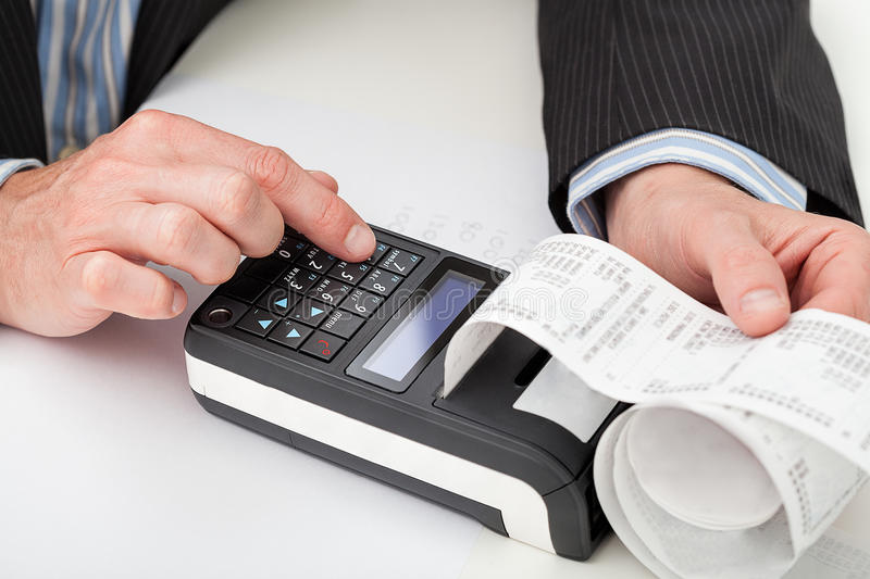 Hands with cash register stock photo
