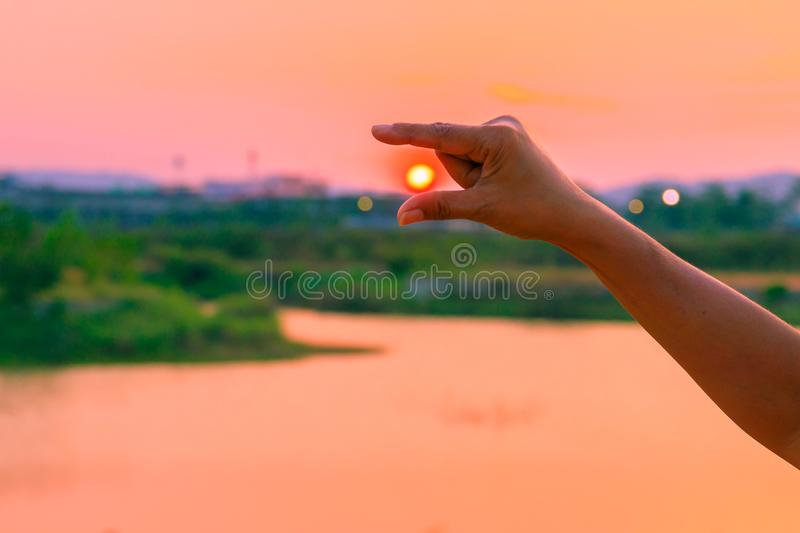 Hands catch sun at sunset time concept. with copy space stock photos
